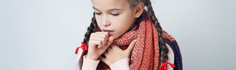 Young sick girl with scarf on grey background